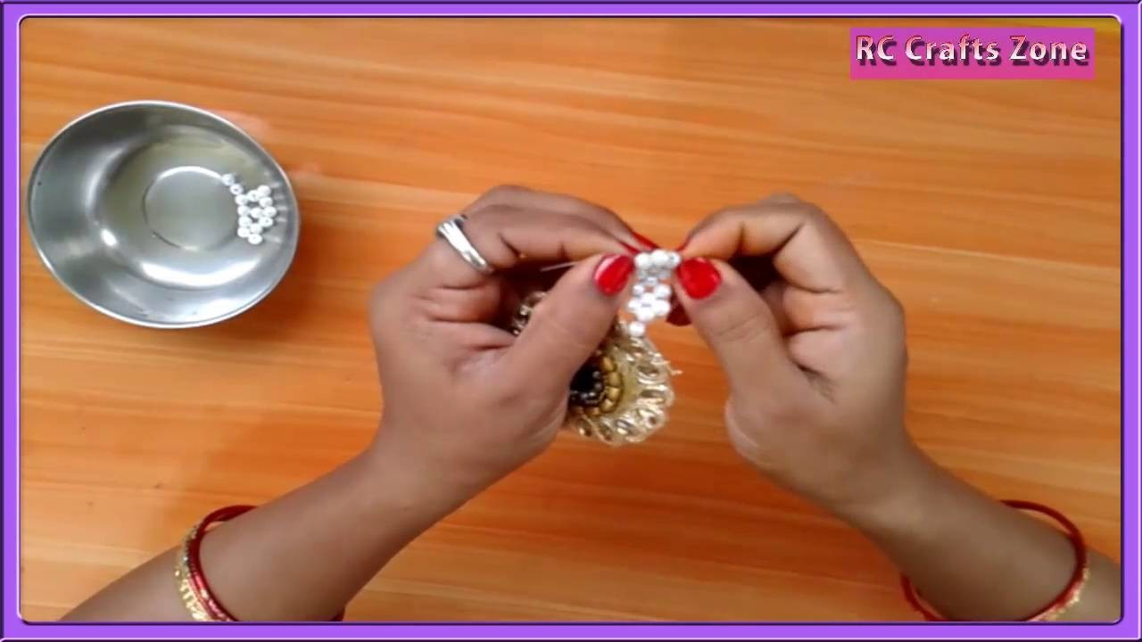 How to prepare a rakhi with pearls