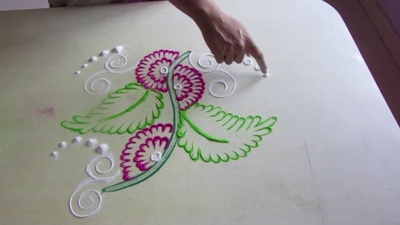 Rangoli design simple rangoli design how to make rangoli for Home made rangoli designs