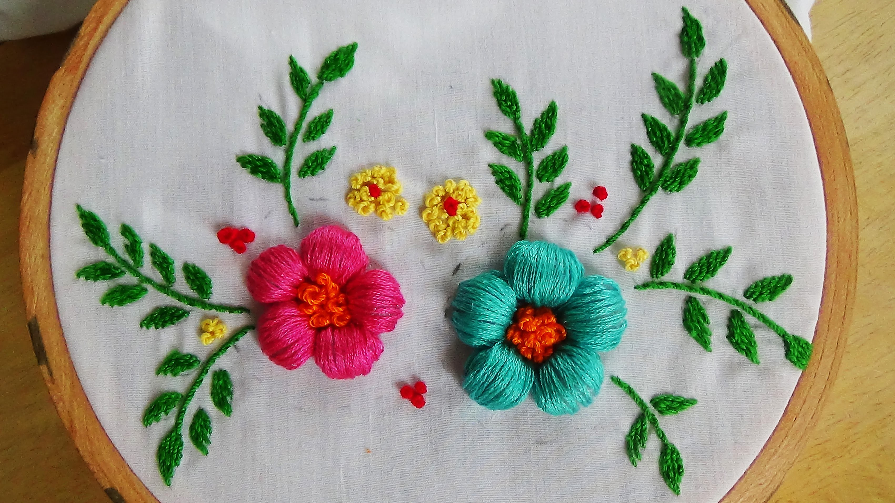 Hand embroidery puffed satin stitch