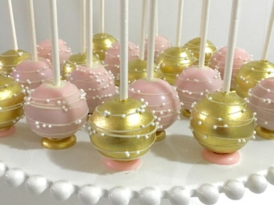 Upside down pink & gold Cakepops with flat bottom base and stripes.swirls design