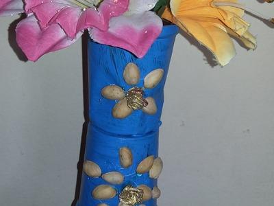 Plastic glasses & pista shell flower vase