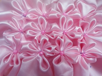 8 petal flower smocking pattern on a fabric