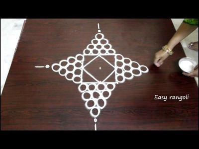 Rangoli designs for diwali with 5 to 1 straight dots- muggulu designs with dots- simple kolam