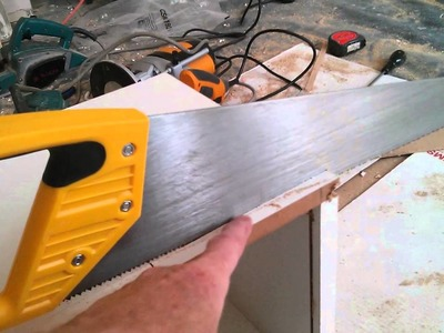 DIY method for fixing kitchen wall units to hollow plasterboard wall
