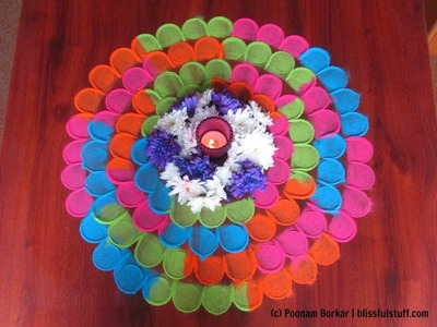 Quick and easy multicolored flower shaped rangoli using tealight candle | Rangoli by Poonam Borkar