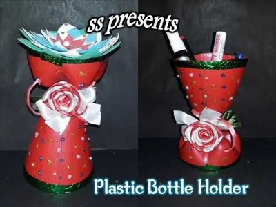 Waste bottle crafts | DIY bottle pen holder. Bottle multi purpose holder. bottle flower holder