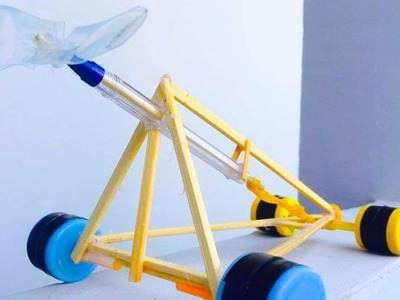 How To Make a  Rubber Band Powered Car - Air Car Using Rubber Band