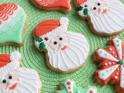 3 Christmas Cookie Designs using Wilton Cookie Cutters Santa, snowflake & ornament cookies