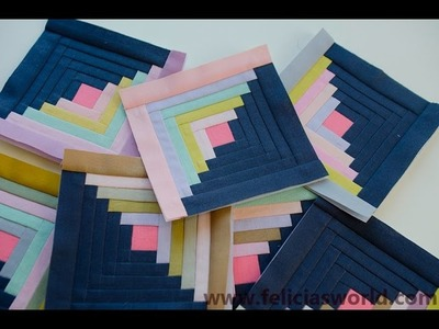 Making small log cabin blocks with paper piecing.