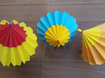 How to make an Origami paper umbrella that open and closes- Easy step by step process.