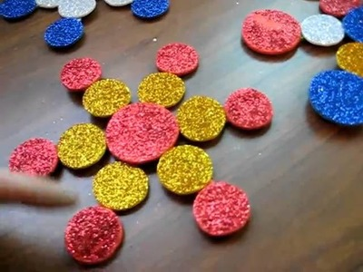 Christmas. Arts and Crafts: Color glitter foam snowflakes on Popsicle sticks activity.