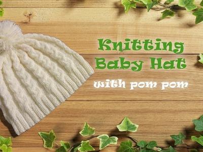 Knitting baby hat with pom pom