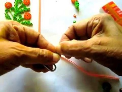 Quilling small leaves & flowers with a corned beef can opener