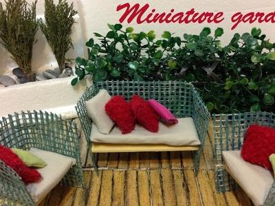 Miniature small garden. Dollhouse. Summer furniture.