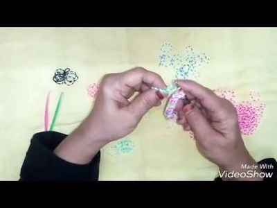 Learn how to make a bracelet using loom bands in just 8 minutes. (Urdu.Hindi)