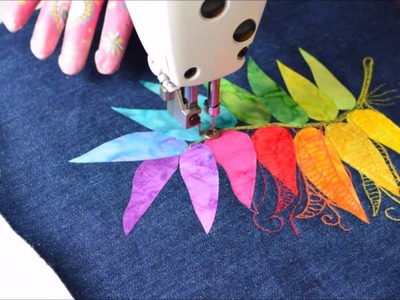 How to make a rainbow feather using thread drawing.