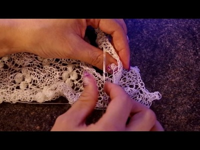 Sewing on the lace edging for Estonian lace shawl