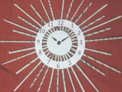 DIY: How to make wall clock with news paper tubes. rolls  - sun model - best out of waste craft