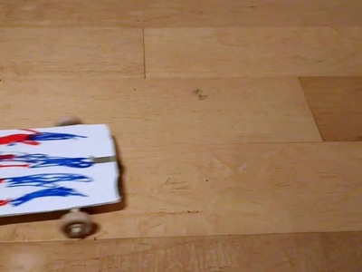 A DIY pull-back car a child can make using a retractable badge holder