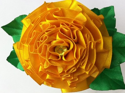 The decoration on the hairband Kanzashi. Flower Marigolds (Tagetes)