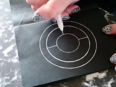 WHITE MANDALA DESIGN ON BLACK PAPER
