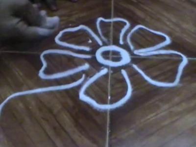 Flower rangoli designs video s how to make flower rangoli how to make rangoli patterns