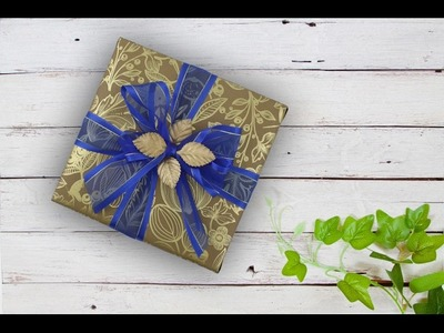 Creative Gift Wrapping using brown gold-foil paper and blue sheer ribbon