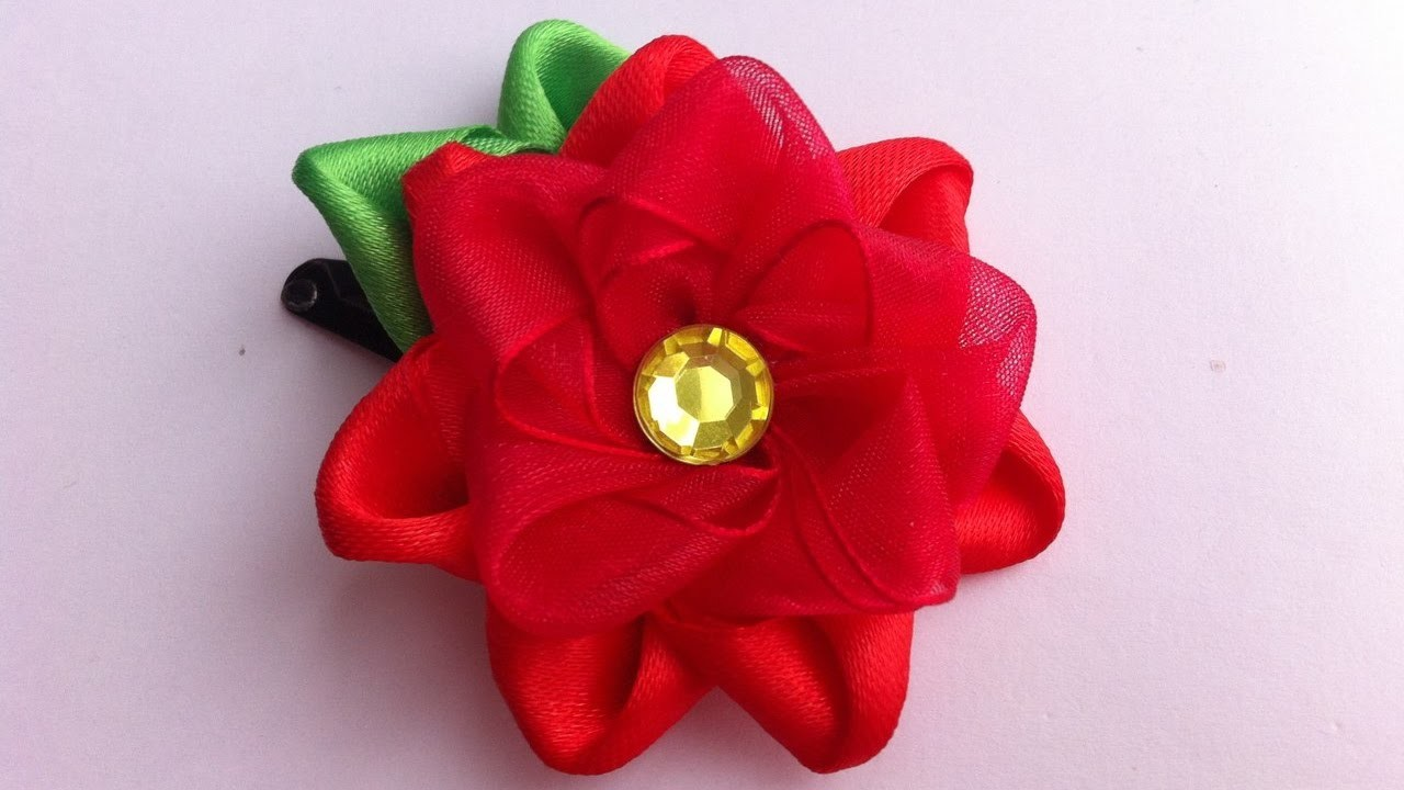 The decoration on the hairpin Kanzashi. the Red flower of satin and organza