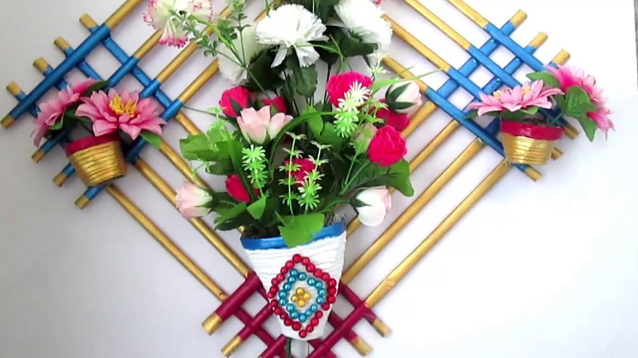 Newspaper flower vase diy newspaper crafts best out of for Wall hanging out of waste