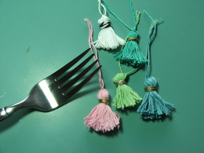 Tiny tassels made with a fork???? huh??
