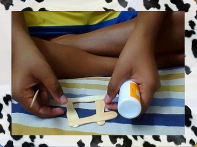 How to make a simple stamp size photo frame using ice cream sticks