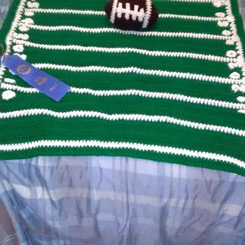 Award winning hand crocheted baby blanket with football
