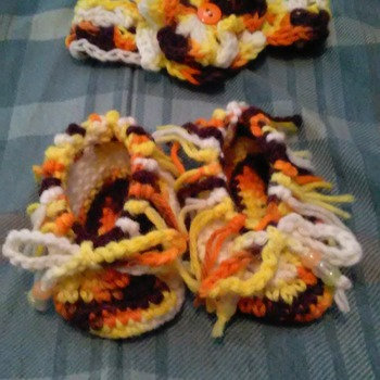 Hand crocheted baby mocasins with matching headband.
