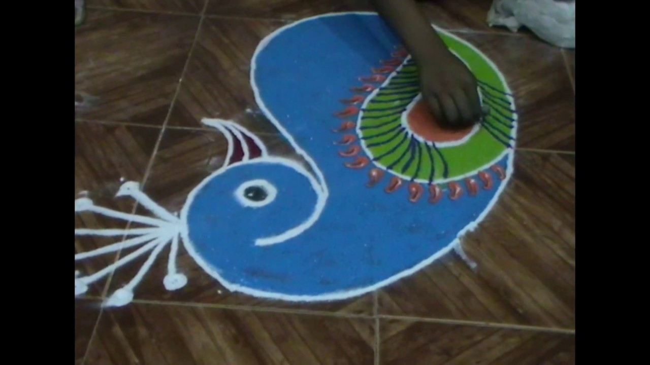 Easy rangoli how to make diwali special peacock rangoli for Home made rangoli designs