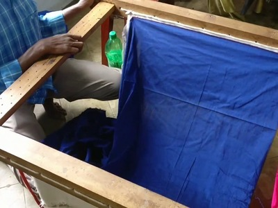 Setting up the embroidery frame for a kurta with 3 different colours