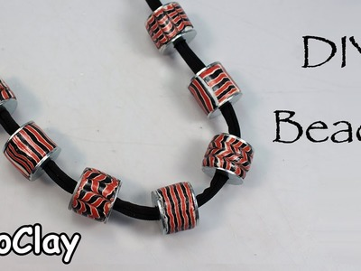 DIY polymer clay beads with metal rings.