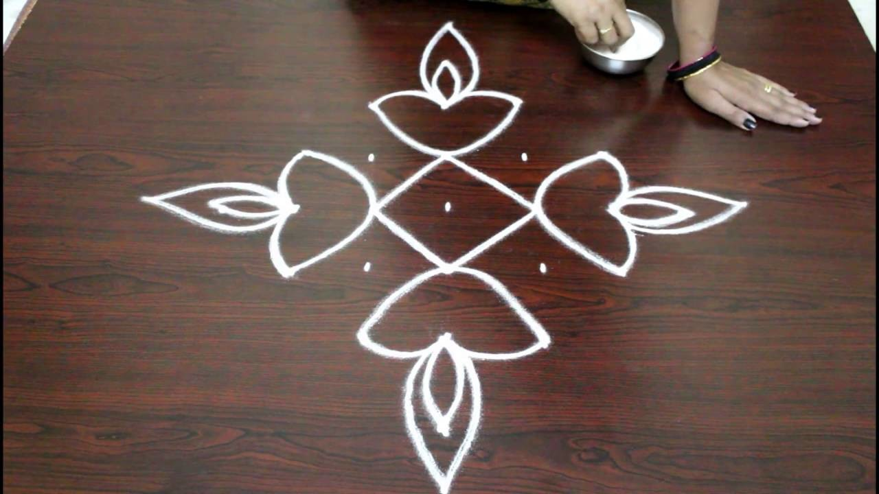 easy rangoli designs for diwali with 7 to 1 dots deepam