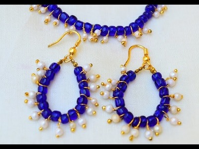 Fashion Jewelry: blue and pearl charm earring and necklace set