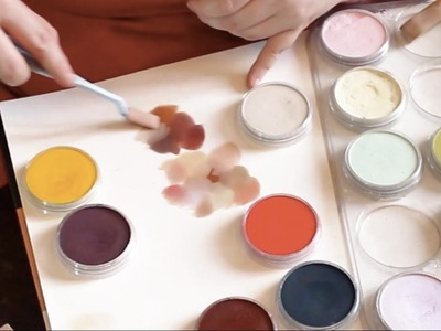 Quickie on mixing skin tones with pan pastels from a few colours.