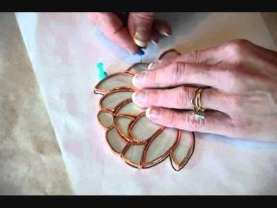 Stained Glass 316.518.1804   - Wichita's Nancy Bole builds a stained glass suncatcher