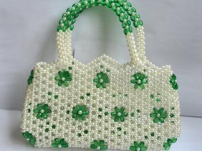 পুতির ব্যাগের সাথে হাতল জোড়া দেয়া।how to mending a handle with a purse bag