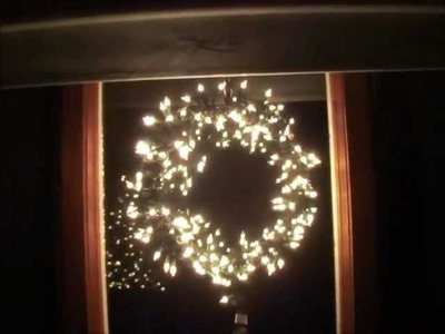 Reused items to make lighted Christmas window wreath.