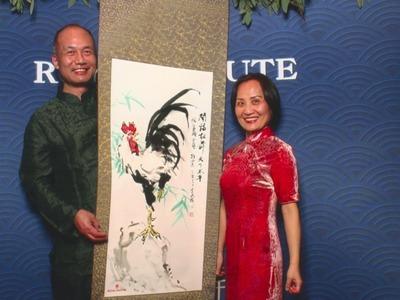 Henry Li painting a rooster scroll for Duke Argyll