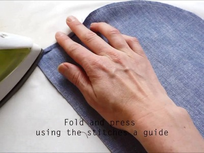 Curved double fold hem using a stitched guideluine