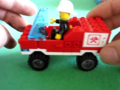 Assembles a forklift toy with lego brick