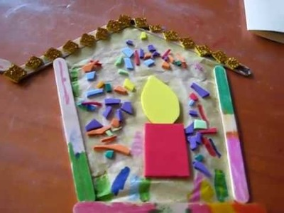 Christmas. Arts and Crafts activity: Popsicle sticks with colored paper and foam.