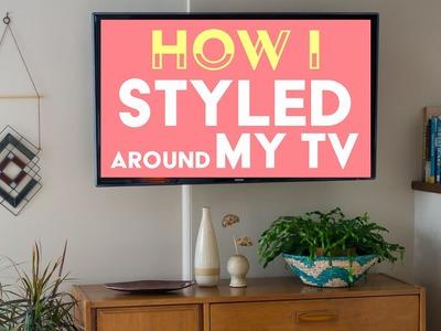 How I Styled Around My TV with Vintage Decor. Sarah Neylan