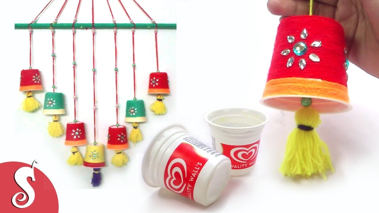 How to make wall hanging from waste ice cream cups i best for Wall hanging best out of waste