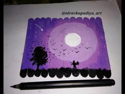 Painting on ice cream sticks
