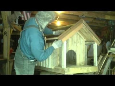 Homemade dog house made from pallets